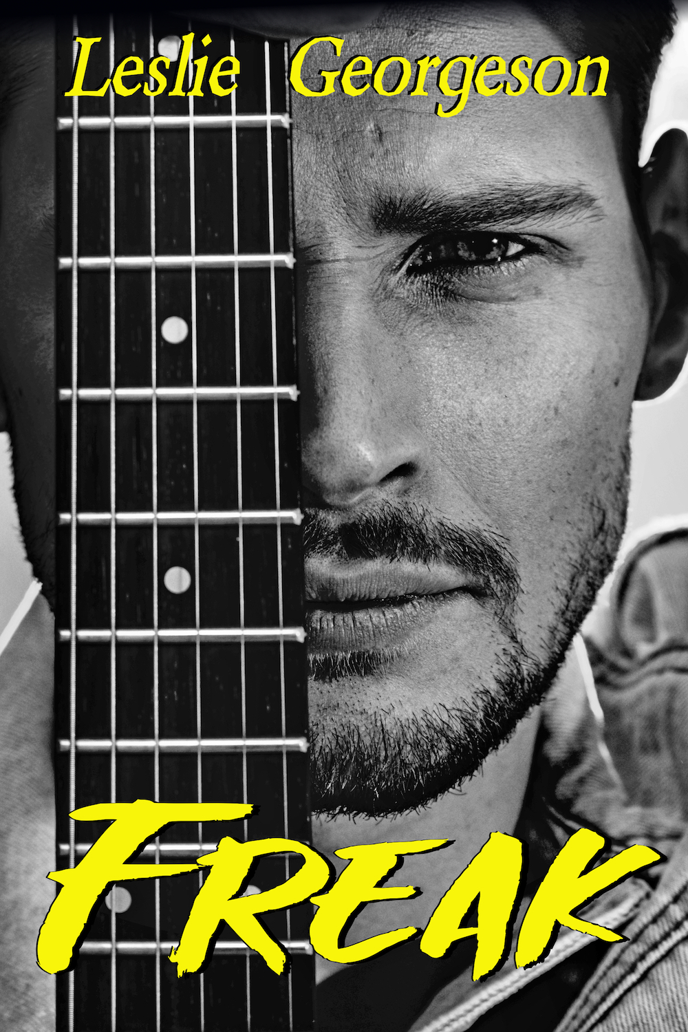 Cover image of Freak by Leslie Georgeson. Features a man's face, half covered by the neck of a guitar, with the author's name at the top and the book title at the bottom, both written in yellow font.